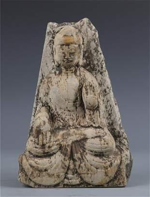 A Carved Stone Buddha Statue