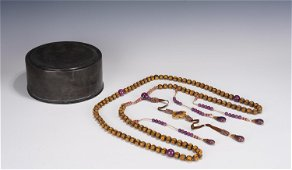 AN IMPERIAL ALOES-WOOD ROSARY WITH TIN BOX