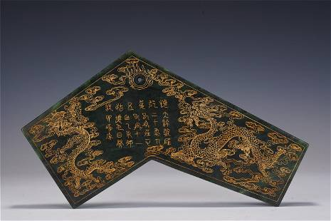 AN INCISED SPINACH GREEN JADE MUSIC INSTRUMENT