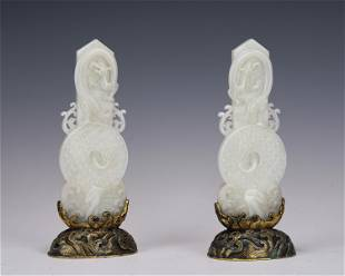 PAIR CARVED WHITE JADE GUI DECORATIONS