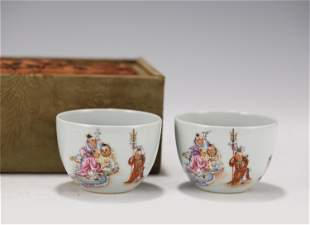 PAIR FAMILLE ROSE FIGURAL CUPS