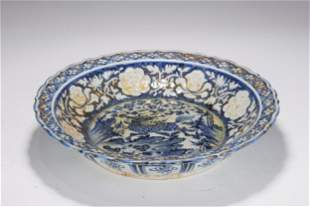 A BLUE AND WHITE LOBED DISH