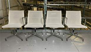 Four Eames Aluminum Group by Vitra Chairs