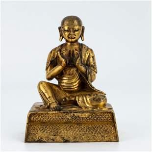 A Gilt-bronze Figure of Arhat