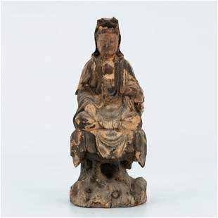 A Carved Wooden figure of Guanyin