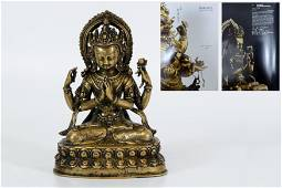 A Gilt-bronze Figure of Guanyin with Four Arms
