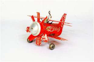 Hangable biplane toy made from Coca-Cola cans