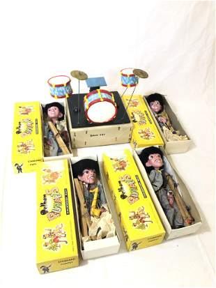 A Full Set of 4 Pelham Beatles Marionettes and Drum Set