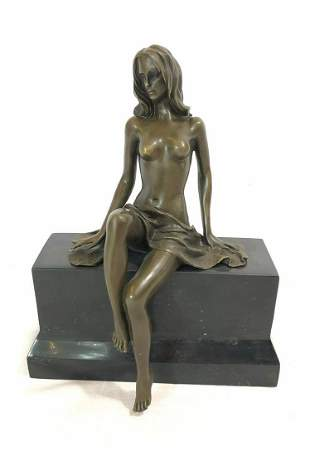 Bronze statue of a woman by artist Claude