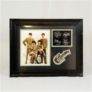 Framed Beatles memorabilia