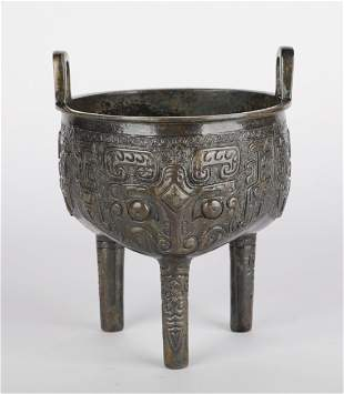 Shang Dynasty - Bronze Tripod with Animal Face Pattern