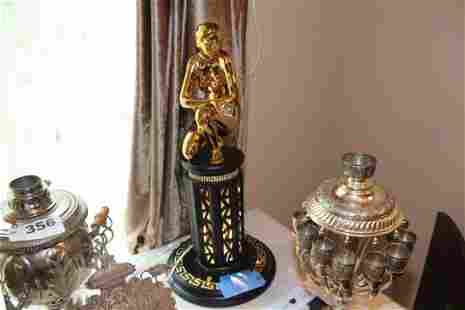 Gold tone figure lamp