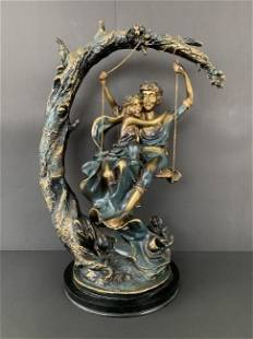 Beautiful resin and alabaster couple statue on swing