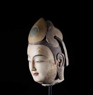 Han white jade Buddha's head in Northern Qi Dynasty