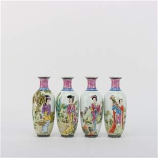 A Set of Four Enamel Vases