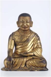 A GILT COPPER GURU BUDDHA STATUE.