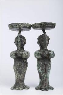 A PAIR OF BRONZE LAMP HOLDERS.