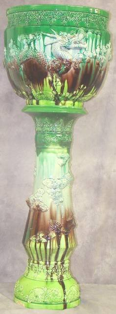 1231: LARGE VICTORIAN GLAZE DRAGON PLANTER ON STAND