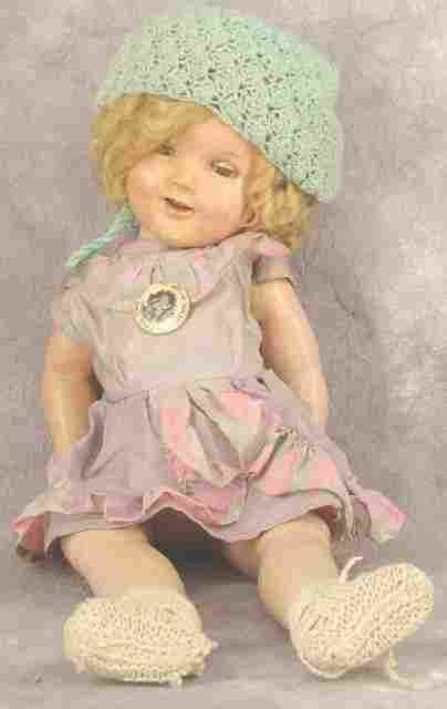 VINTAGE SHIRLEY TEMPLE DOLL & BADGE