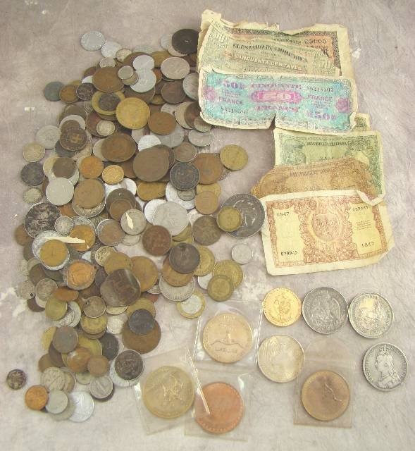 22: TIN ASSORTED WORLD COINS & BANK NOTES