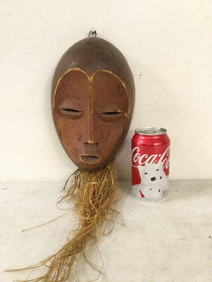 "AFRICAN MASK WITH STRAW, MEASURES 9 3/4"" X 6 1/2"","