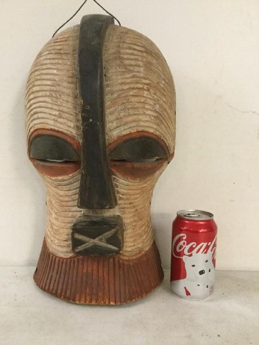 "AFRICAN MASK, MEASURES 16"" X 9 1/4"", ORIGIN UNKNOWN,"