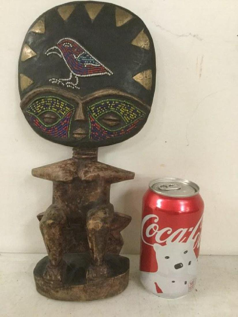 AFRICAN STATUE WITH BEADED BIRD & BEADS AROUND EYES,