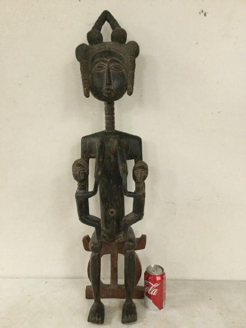 "AFRICAN STATUE, MEASURES 53 1/2"" H X 4 1/2"" D X 4"" WIDE"