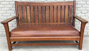 L & JG STICKLEY SETTLE WITH LEATHER SEAT, STAMPED ON