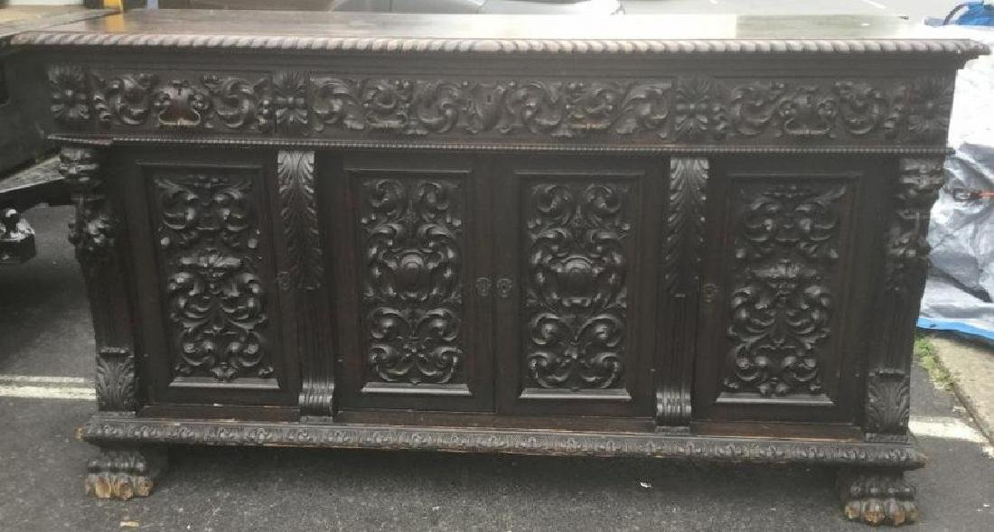 HEAVILY CARVED OAK SIDEBOARD W/LION HEADS, CLAW FEET,