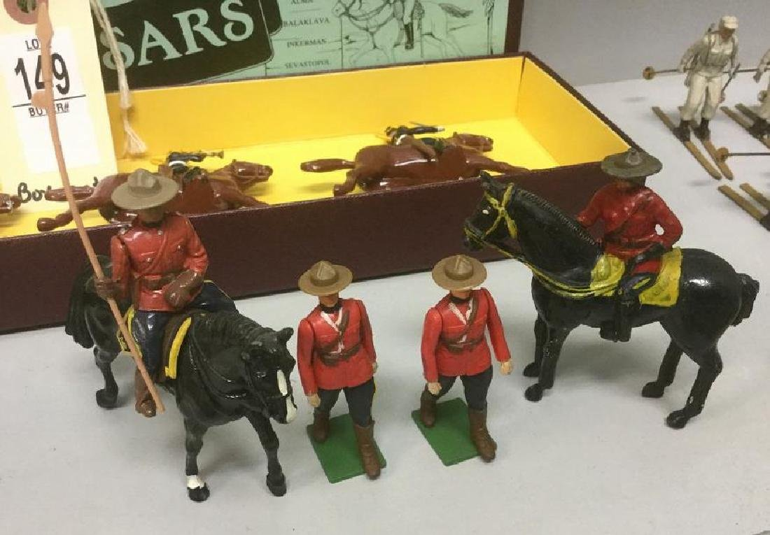 BRITAINS SOLDIERS- 4 PCS ROYAL CANADIAN MOUNTED POLICE,
