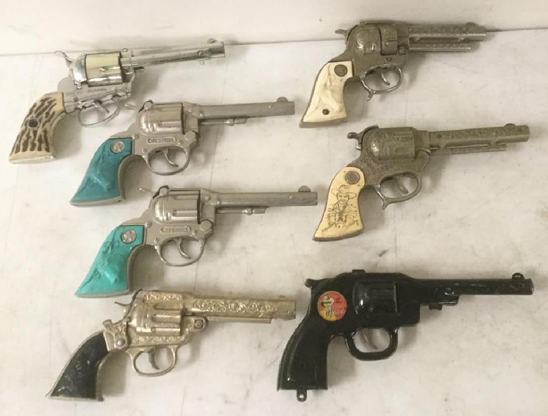 LOT OF 7 OLDER WESTERN CAP GUNS INCLUDING TEXAN JR.,
