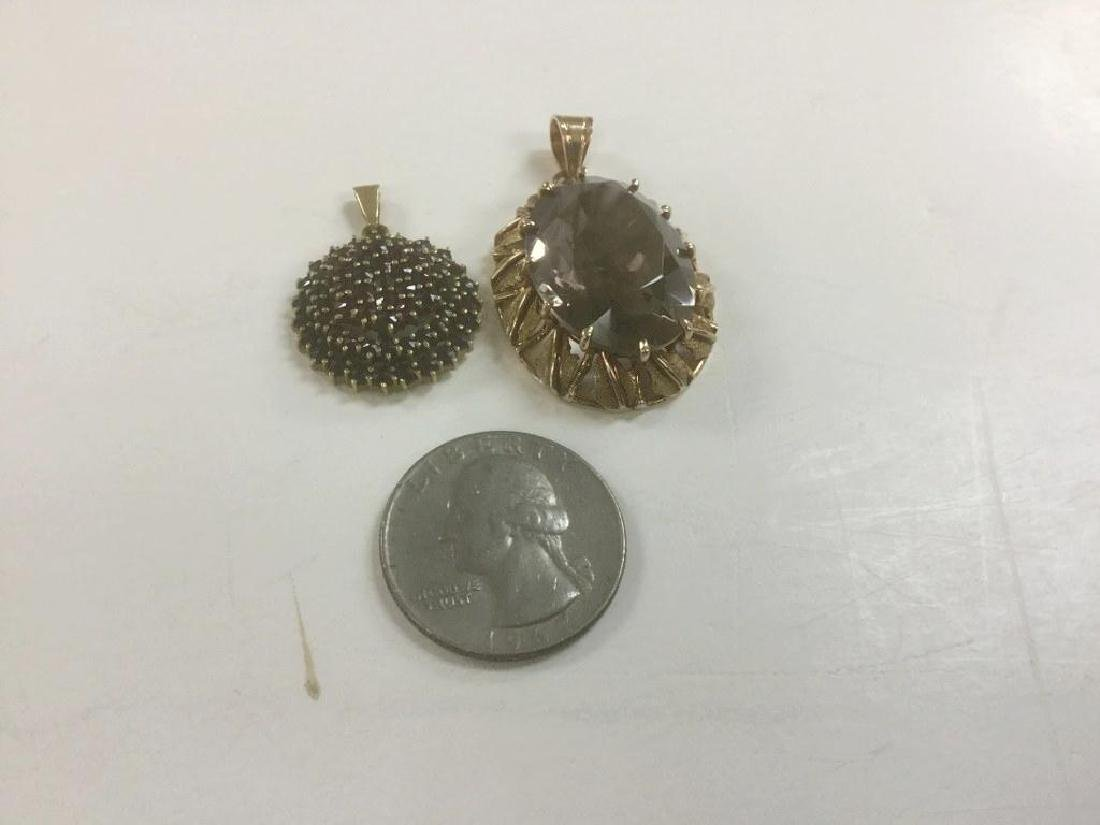 (2) 18K PENDANTS 1 WITH SMOKEY TOPAZ (?) AND OTHER WITH