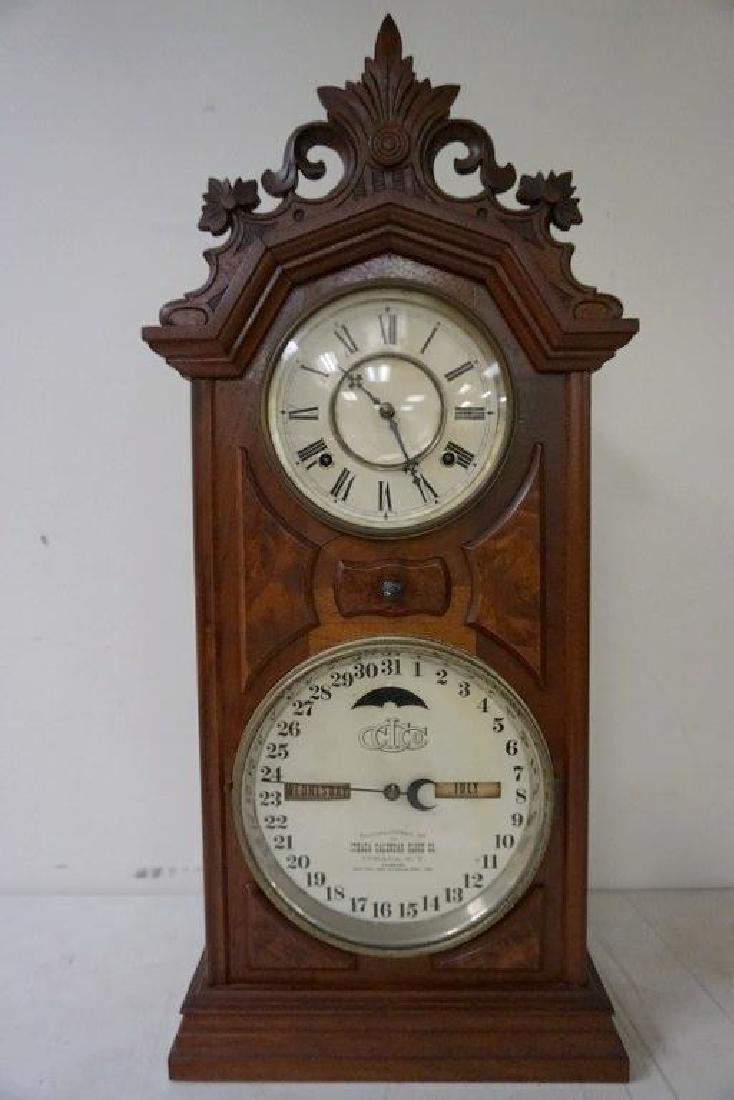 ITHACA CALENDAR CLOCK, VICTORIAN PERIOD, WALNUT,