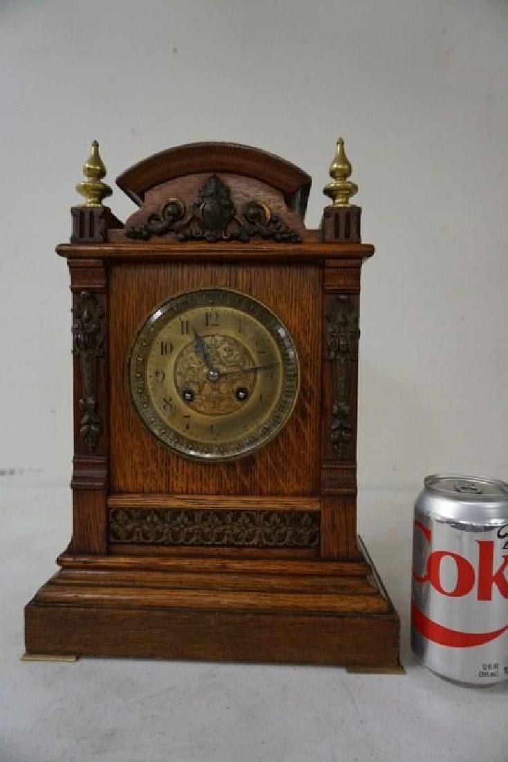 QUALITY OAK MANTEL CLOCK WITH BRASS FINIALS, DECORATIVE