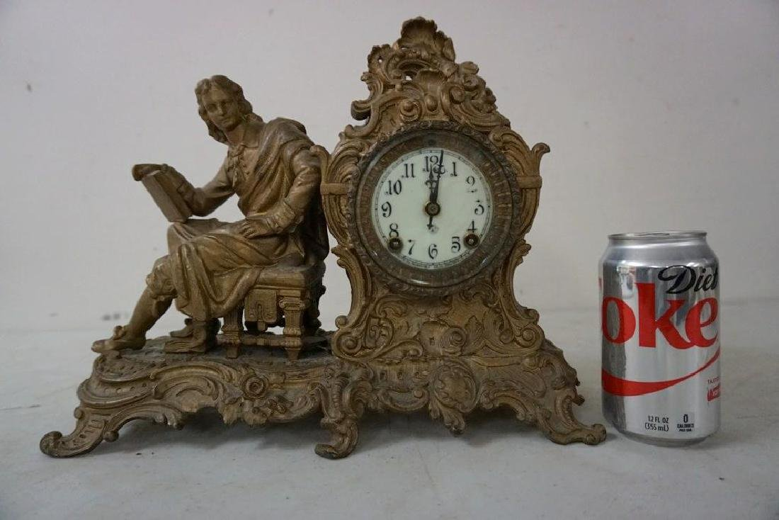 ANSONIA FIGURAL MANTEL CLOCK WITH MAN HOLDING BOOK,