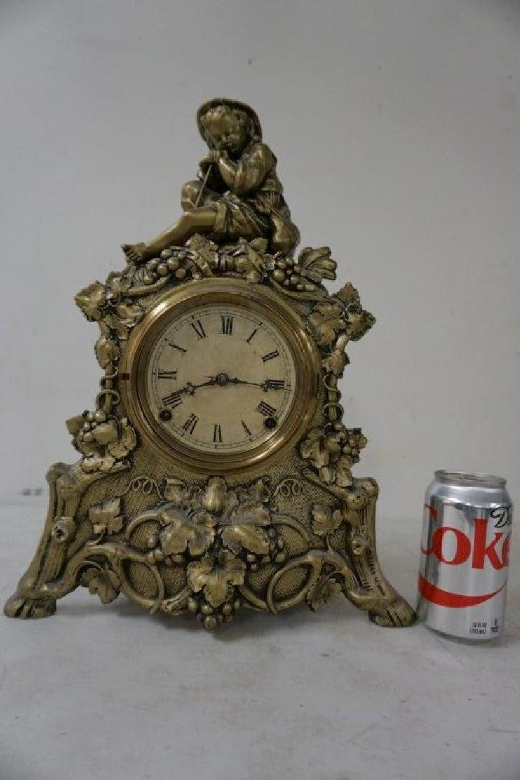 NOVELTY MANTEL CLOCK WITH YOUNG BOY SEATED ON TOP,