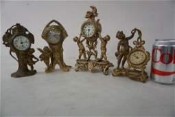 4 CHERUB FIGURAL NOVELTY CLOCKS, TALLEST ONE MEASURES