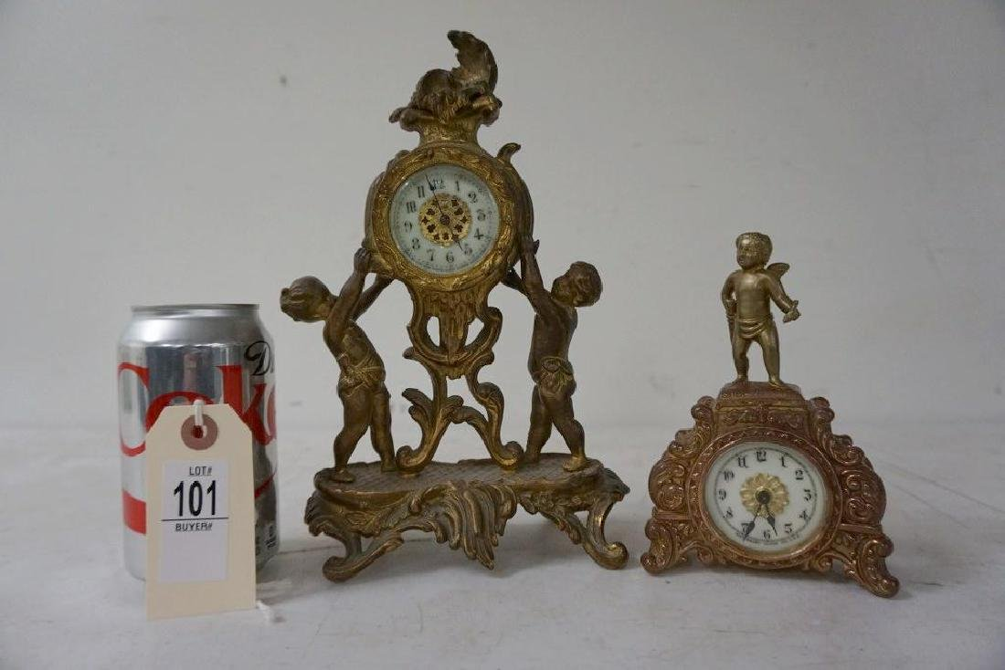 2 WHITE METAL FIGURAL MINIATURE CLOCKS, PORCELAIN