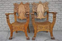 PR QUARTER SEWN OAK CARVED ARMCHAIRS WLION HEADS