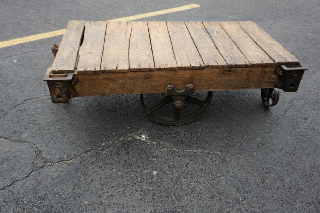 OLD INDUSTRIAL CART WITH LARGE CAST IRON WHEELS,