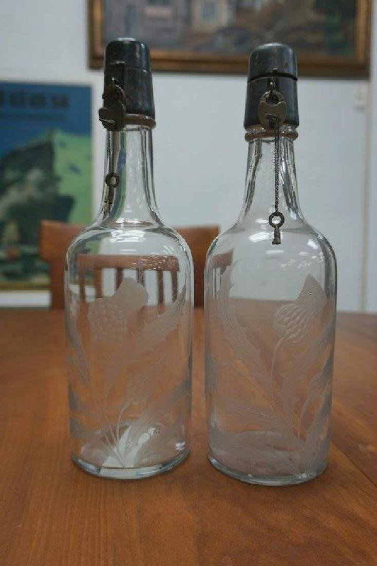 PAIR OF EARLY ETCHED STERLING TOP LIQUOR BOTTLES, NICE