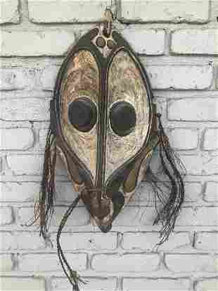 OLD AFRICAN UNUSUAL MASK, POLYCHROMED, FROM WOODSTOCK,