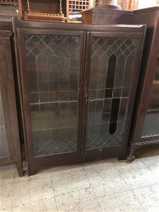 AS FOUND 2 DOOR LEADED GLASS OAK BOOKCASE, BROKEN