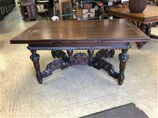 OAK REFRACTORY TABLE W/CARVED BASE AND APRON, WAS USED