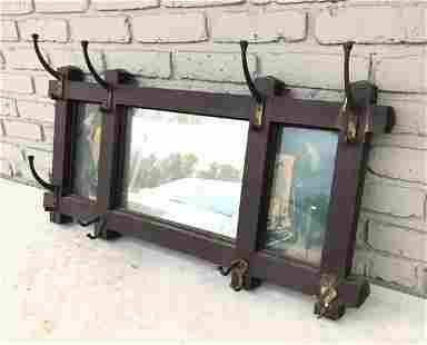CIRCA 1920'S ARTS & CRAFTS MIRROR WITH HOOKS AND 2