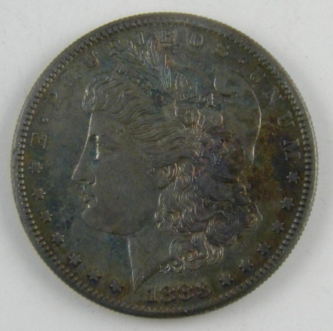 8F: 1883 S Morgan Silver Dollar Rainbow Toned Uncircula