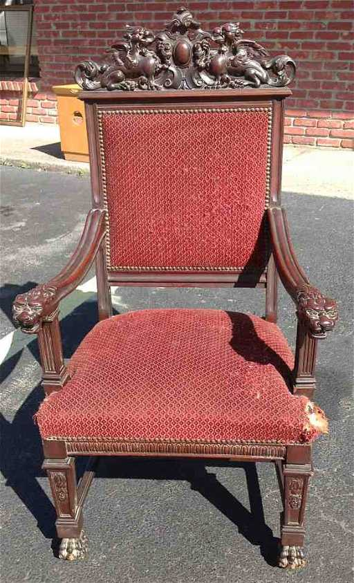 - MAHOGANY ARMCHAIR W/LION HEAD ARMS AND FULL CARVED LION