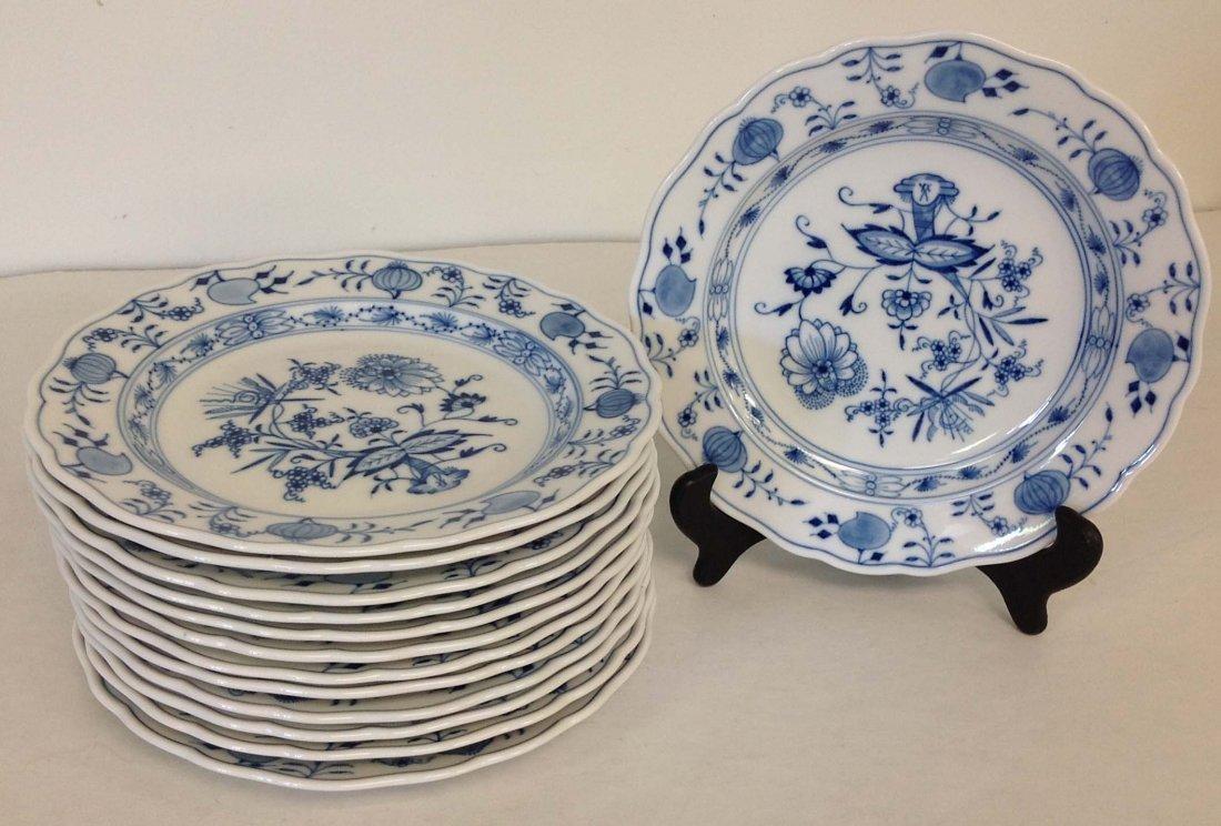 13 Meissen Blue Onion pattern salad plates, all crossed