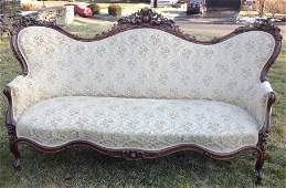 CARVED ROSEWOOD VICTORIAN SOFA, ATTRIBUTED TO